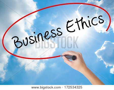 Woman Hand Writing Business Ethics With Black Marker On Visual Screen