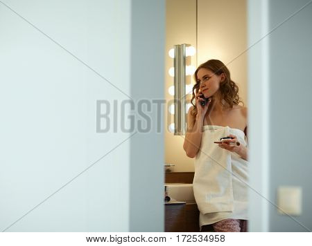Young woman standing on bathroom