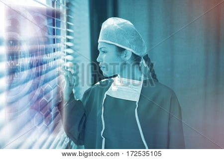 Medical interface on xray against female surgeon looking through window 3d