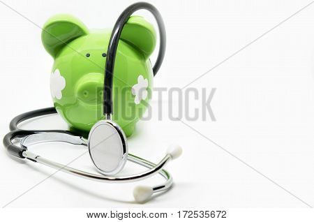Piggy bank and stethoscope isolated on white background