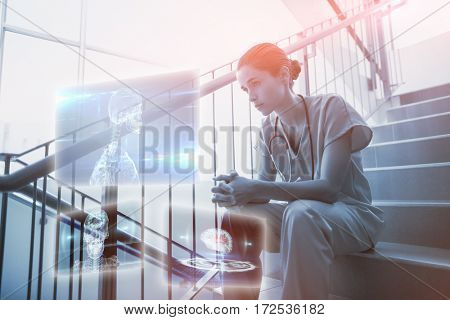 Skeleton graphic on blue with lights against upset female surgeon sitting on staircase 3d
