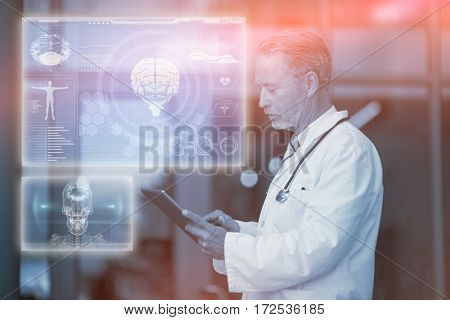 Medical biology interface in blue against male surgeon using digital tablet 3d
