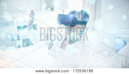Futuristic screen with quaders against happy senior woman using virtual headset on bed 3d