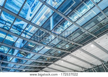 Directly Below Shot Of glass Skylight in a modern building.