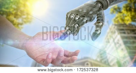 Hand of man pretending to hold an invisible object against low angle view of building