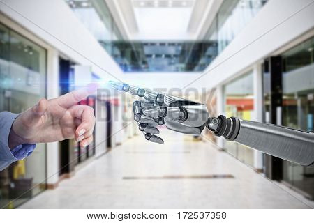 Businesswoman hand using digital screen against interior of modern shopping mall