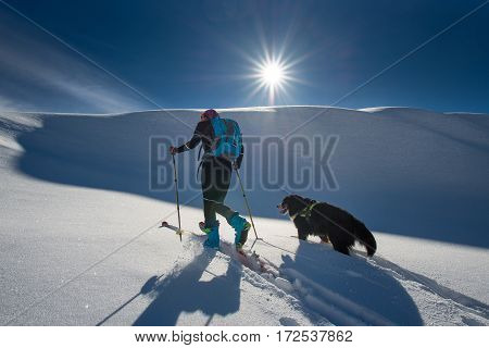 Girl Makes Ski Mountaineering With His Dog