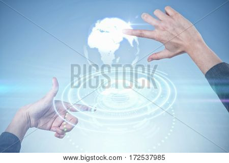 Businesswoman holding invisible card against digital image of earth over circular light trail