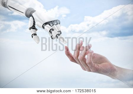 Hand of man pretending to hold an invisible object against sky