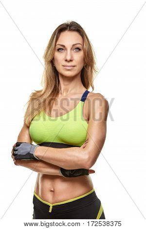 Portrait of female bodybuilder with crossed arms