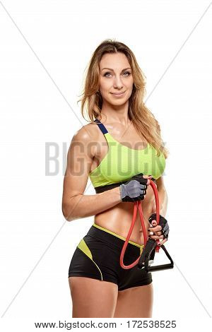 Portrait of smiling sportswoman doing exercises with expander