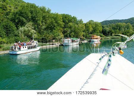 Tourists On A Boat At The River Who Takes To The Krka National Park