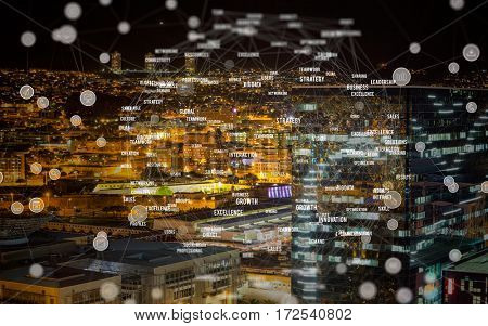 Blue circular shape computer icons against high angle view of illuminated crowded cityscape