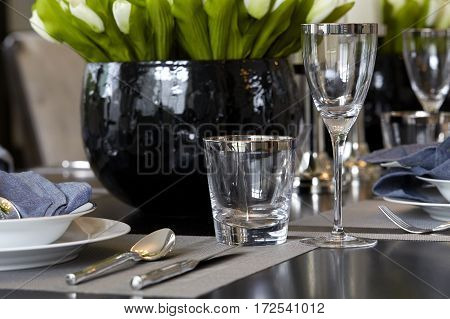 Empty glasses set in dining room fork, setting, cloth, tablecloth,