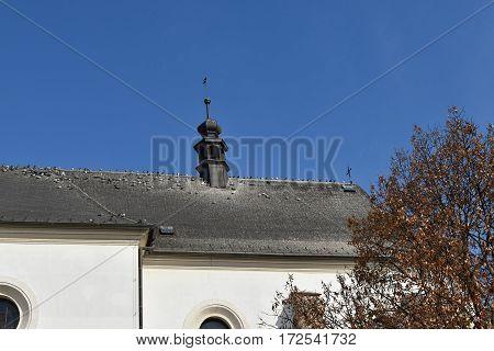 Pigeons on church roof. Blue sky. Pigeons.