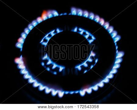 the fire of the gas stove over black background