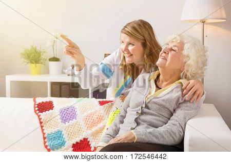 Grandma and health proffessional looking at something