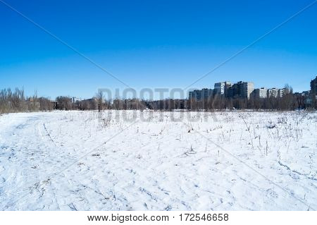 desolate snowy winter outdoors in sunny weather