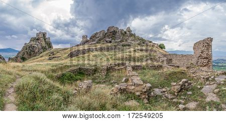 Ancient high hill fortress on cloudy day