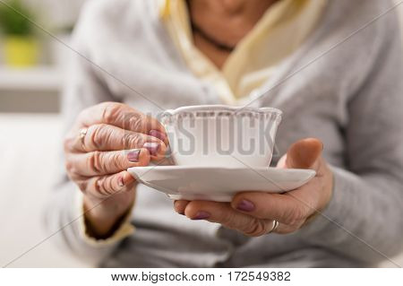 Grandma having a cup of coffee or tea