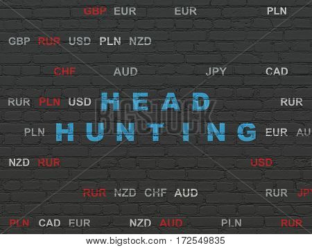 Business concept: Painted blue text Head Hunting on Black Brick wall background with Currency