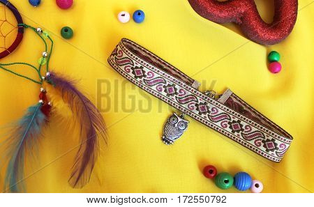 handmade pink choker with owl on the yellow background