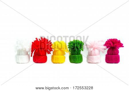 colors Funny in mini hats isolated on white backgrounds close-up