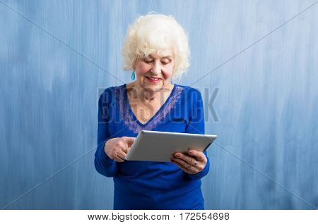 Grandma learning how to use tablet computer