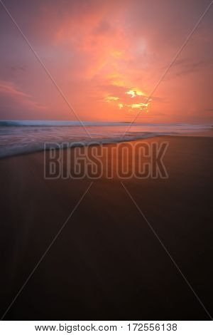 Sunset clouds and waves on empty beach Costa Rica