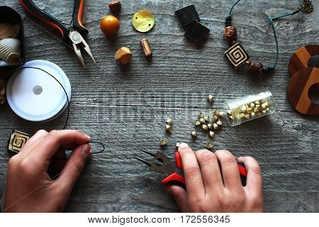 handmade accessories making tools on the wooden table