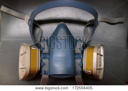 Multi purpose respirator half mask on grey wall background