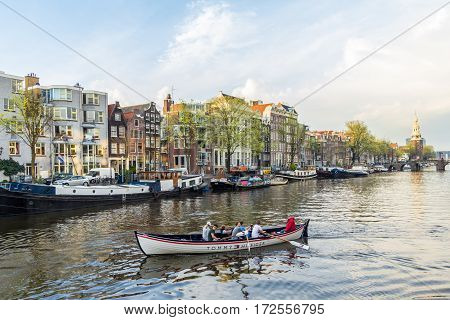 Amsterdam the Netherlands - April 13 2016: beautiful Amsterdam canal scene