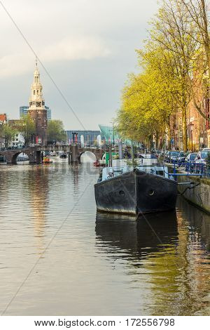 Amsterdam the Netherlands - April 13 2016: Amsterdam canal scene landscape