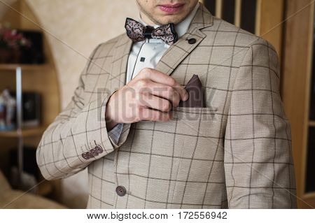A man correct handkerchief in his jacket pocket. Men's style. Professions. To prepare for work to the meeting.