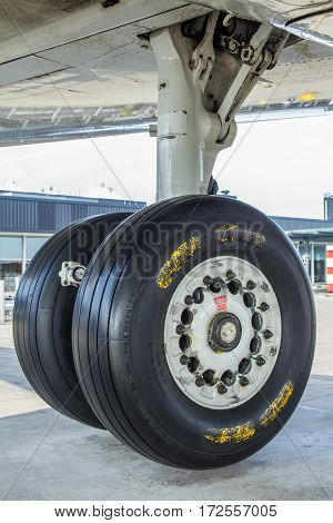 Amsterdam Schiphol Airport North Holland/the Netherlands - March 10 2016: undercarriage of KLM Fokker 100 passenger aircraft on viewing platform
