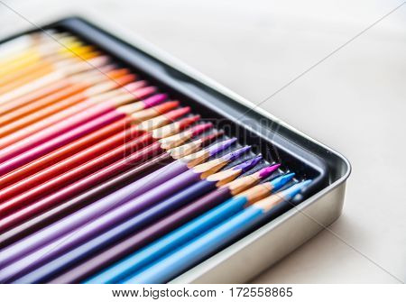 Colored wooden crayon set in the metall box, pencils