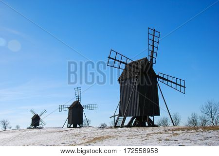 Old wooden windmills in a row at the swedish island Oland. Windmill are iconic symbols for the island Oland the island of sun and wind
