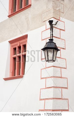 Old street lamp hanging on the wall of a house