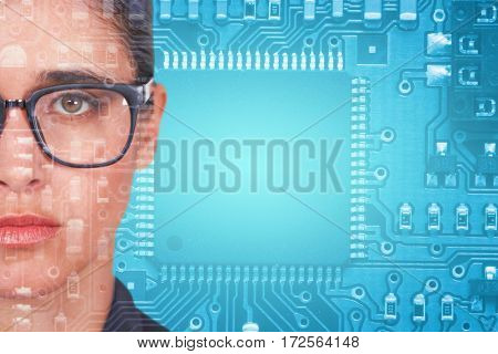 Woman wearing spectacles against blue electronic circuit
