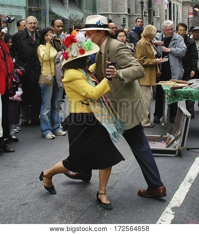 Couple dancing at the Easter Parade on 5th avenue in New York City. March 27 2005 - New York USA