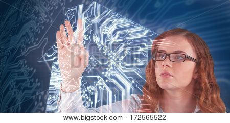 Woman touching invisible screen against house shapeon circuit board