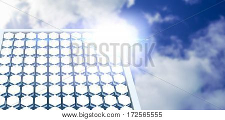 Hexagon solar panel equipment against white screen against bright blue sky with clouds
