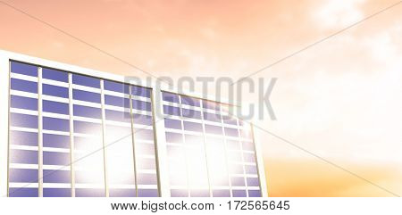 Illuminated solar panel against sunset with clouds