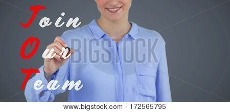 Businesswoman writing on imaginative digital screen against grey background