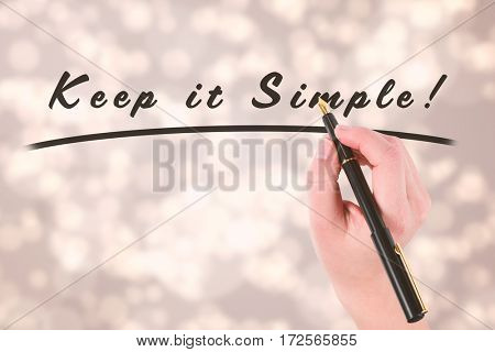 Businesswomans hand writing with fountain pen against light glowing dots design pattern