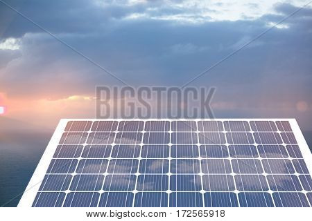 Solar panel with hexagon shape glasses against scenic view of seascape against cloudy sky