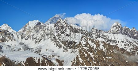 Beautiful panoramic evening view of the Himalayan Range from the top of Gokyo Ri. Blue sky and white clouds on the background. Trek to Everest basecamp.