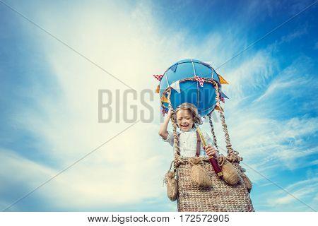 Smiling boy in a balloon