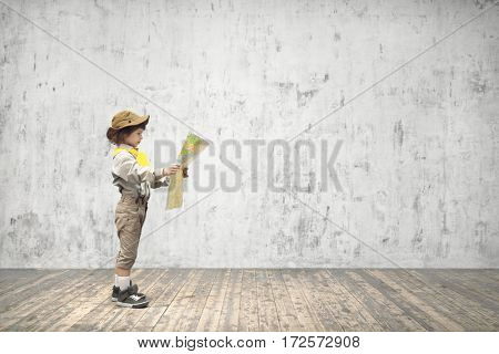 Little boy with map indoors