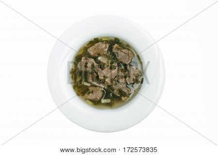 boiled meat with fresh herbs chakapuli  traditional Georgian dish white background top view